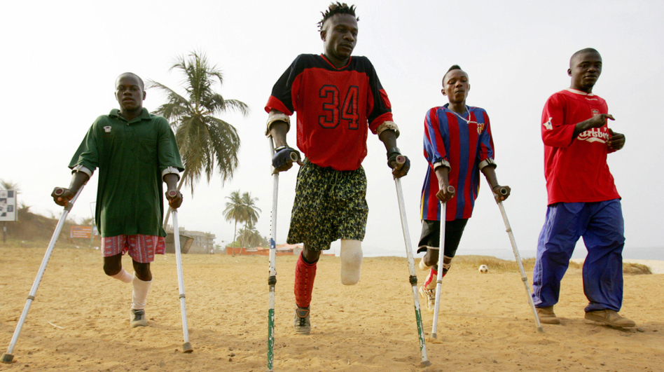 Members of a civil war amputee soccer team practice on a beach in Freetown, Sierra Leone's capital, in April 2006. Rebel groups, allegedly aided by former Liberian President Charles Taylor during Sierra Leone's brutal 1991-2002 civil war, were known for their gruesome practice of hacking off limbs. (AFP/Getty Images)