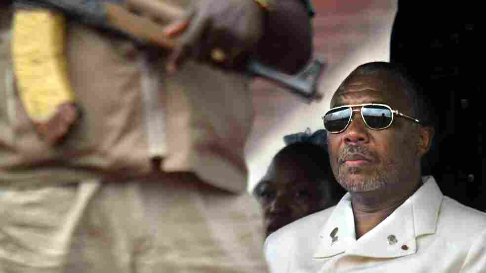 Liberian President Charles Taylor, shown here in the capital Monrovia in 2003, is charged with 11 counts of war crimes and crimes against humanity — including murder, rape, sexual slavery and the use of child soldiers — in nei