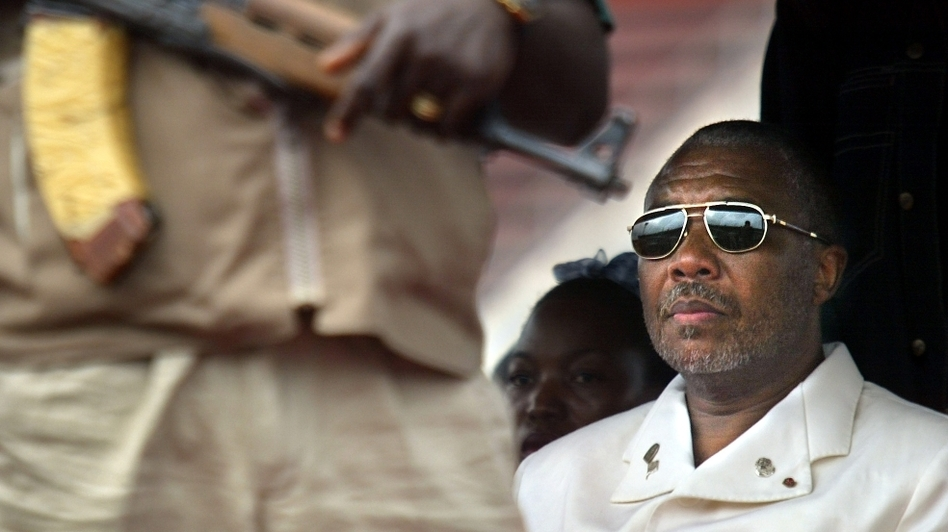 Liberian President Charles Taylor, shown here in the capital Monrovia in 2003, is charged with 11 counts of war crimes and crimes against humanity — including murder, rape, sexual slavery and the use of child soldiers — in neighboring Sierra Leone. A verdict is expected Thursday. (AP)