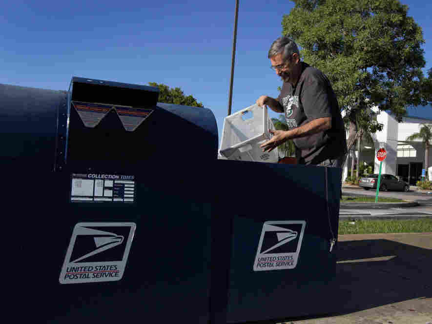 Scott Schechter, a United States Postal Service employee, collects mail from the boxes in front of a mail processing center on September 16, 2011 in Pembroke Pines, Florida. The U.S. Postal Service is considering major cost-saving measures, including the potential closings of 250 facilities nationwide are part of an effort to save up to $3 billion a year. (Joe Raedle/Getty Images)