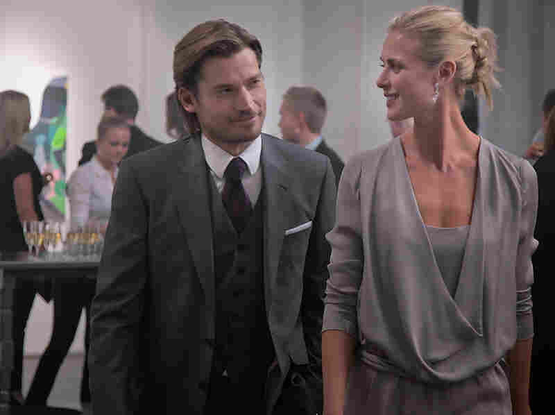 An art-patron client (Nikolaj Coster-Waldau) and Roger's gallery-owner wife (Synnove Macody Lund) get caught up in the explosive aftermath when a heist goes bad.