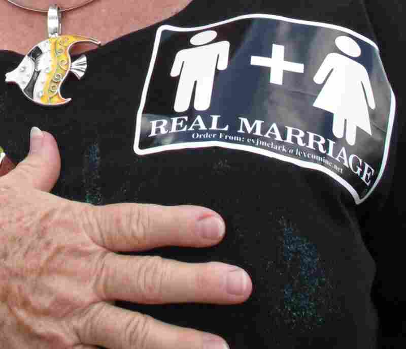 Jennifer Cockrham, a nurse from Walkertown, N.C., holds her hand over her heart for the Pledge of Allegiance during a rally supporting a constitutional ban on gay marriage Friday in Raleigh.