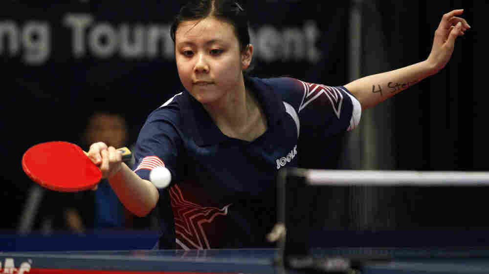 American Ariel Hsing competes against Canadian Chris Xu at the table tennis qualifying tournament in Cary, N.C., on April 20.