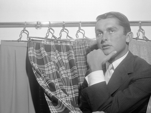 "Is ""slacks"" the worst word in the English language? <em>The New Yorker</em> thinks so. Hollywood producer Robert Evans might disagree. He poses here with some of his most fashionable slacks in 1957."