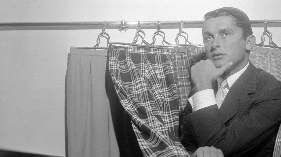 """Is """"slacks"""" the worst word in the English language? <em>The New Yorker</em> thinks so. Hollywood producer Robert Evans might disagree. He poses here with some of his most fashionable slacks in 1957."""