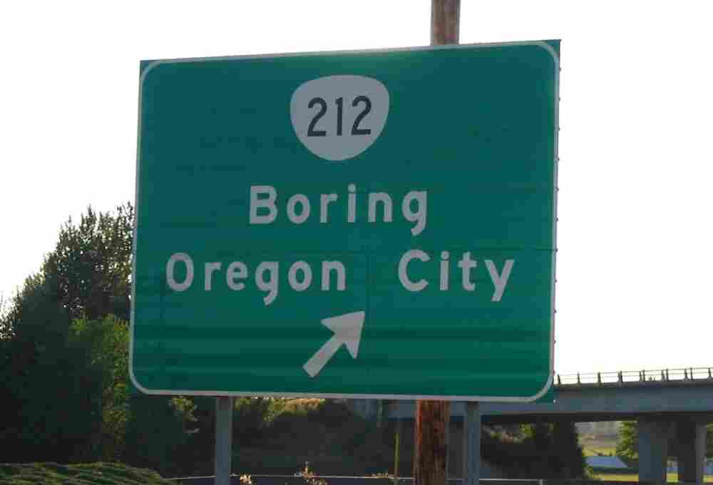 A sign pointing the way to Boring.