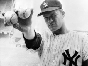 New York Yankees pitcher Jim Bouton holds two balls that his teammates hope will lead them to victory in the 1964 World Series.