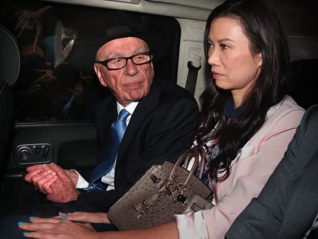 Rupert Murdoch and his wife, Wendi Deng Murdoch, as they were being driven away from the Royal Courts of Justice following his testimony today in London.