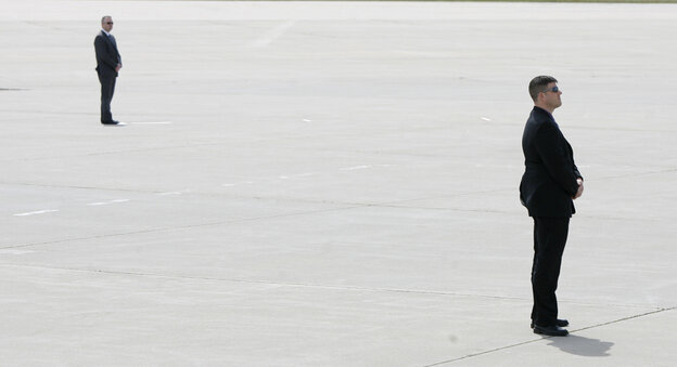 Secret Service agents awaited the arrival of President Obama in Air Force One at Eastern Iowa Airport in Cedar Rapids, Iowa.