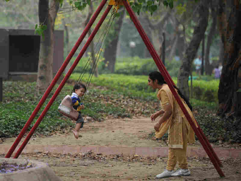 A child rides on a swing at a park in New Delhi on April 15, 2012. Sex selection of foetuses in India has led to 7.1 million fewer girls than boys up to age six, a gender gap that has widened by more than a million in a decade, according to a study released in 2011.