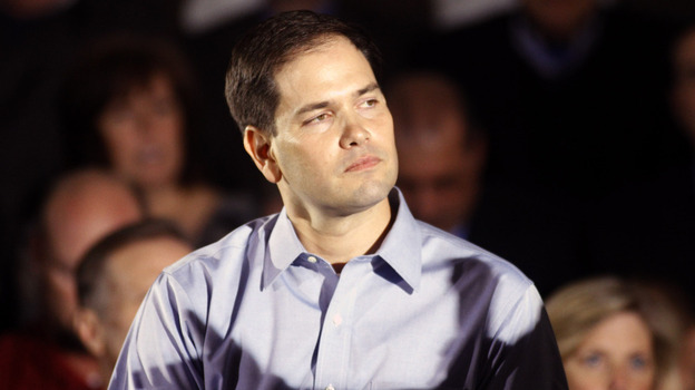 Sen. Marco Rubio, R-Fla., the son of Cuban immigrants, has urged his fellow conservatives to soften their rhetoric on illegal immigration. Above, he makes a campaign stop with Republican presidential candidate Mitt Romney on Monday in Aston, Pa. (Getty Images)