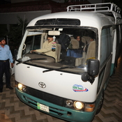 Pakistani policemen escort a minivan carrying family members of slain al-Qaeda chief Osama bin Laden, in Islamabad, earlier today.