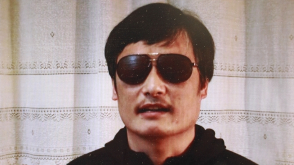 """Blind Chinese activist Chen Guangcheng has fled house arrest despite an around-the-clock presence of security forces. This image is from a video of Chen that was posted Friday on YouTube and elsewhere. """"I am now free. But my worries have not ended yet,"""" Chen says."""