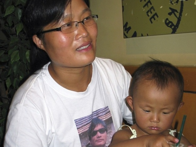 Yuan Weijing, the wife of activist Chen Guangcheng, is shown with the couple's daughter in a 2007 interview in Beijing. The girl, now 6, is followed to school every day by Chinese security agents, who always check her schoolbag, according to Chen. (Reuters/Landov)