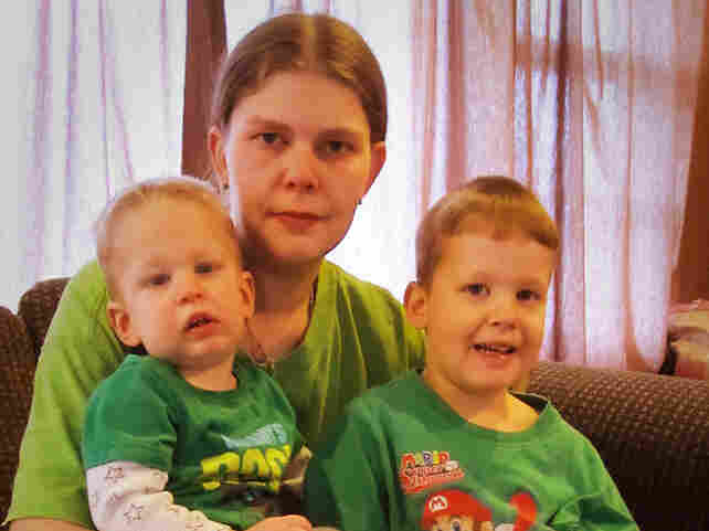 Lori Duff with her baby, Henry, and other son, Logan, at home in Columbus, Ohio.