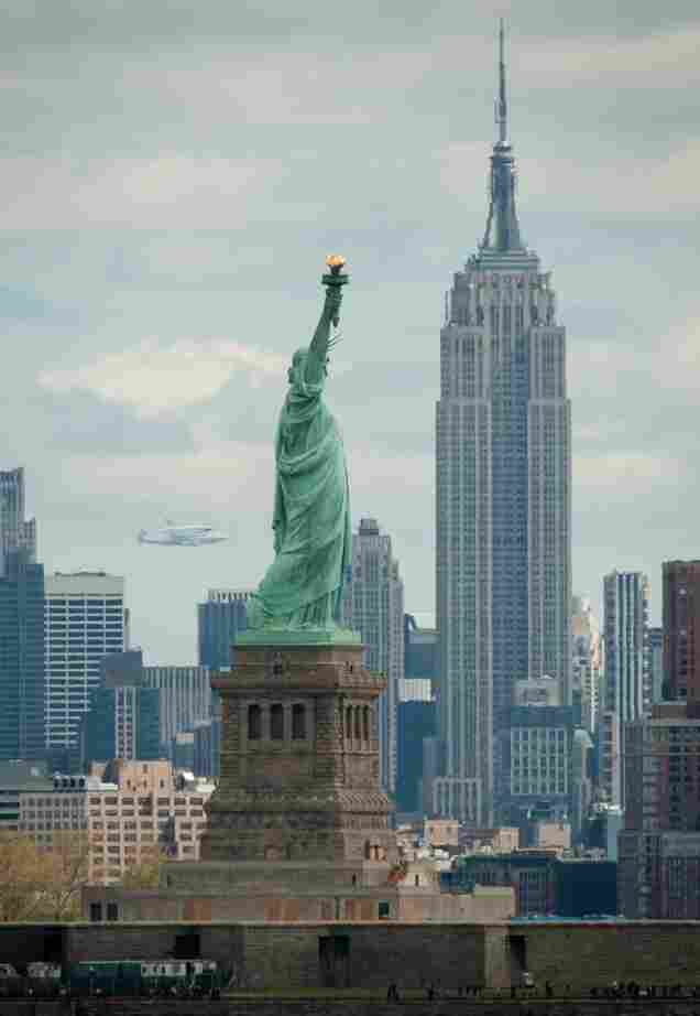 Another view, capturing Enterprise, the Statue of Liberty and the Empire State Building.