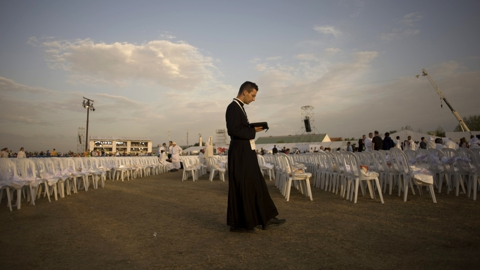 A priest prays before a Mass celebrated by Pope Benedict XVI at the Cuatro Vientos air base outside Madrid during World Youth Day festivities in August 2011. The Catholic Church is hoping to provide an attractive option for young job seekers in Spain, which is suffering from unprecedented unemployment. (AFP/Getty Images)