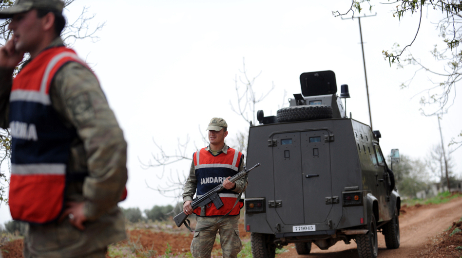 Turkish army personnel patrol near the border with Syria in Kilis earlier this month. Activists and smugglers say it's getting harder to get medical and communications equipment into Syria across the Turkish border. (AFP/Getty Images)