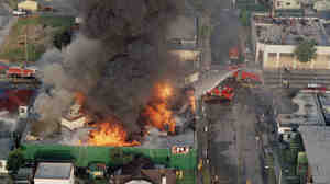 A fire burns out of control at the corner of 67th St. and West Blvd. in South Central Los Angeles on April 30, 1992. Hundreds of buildings burned when riots erupted after the verdicts in the Rodney King case were announced.