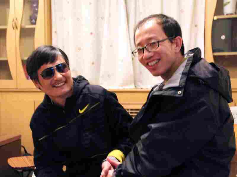 "Chen Guangchen, left, meets with fellow activist Hu Jia at an undisclosed location following Chen's escape. ""Chen's case has become the epitome of China's human rights situation,"" Hu says."