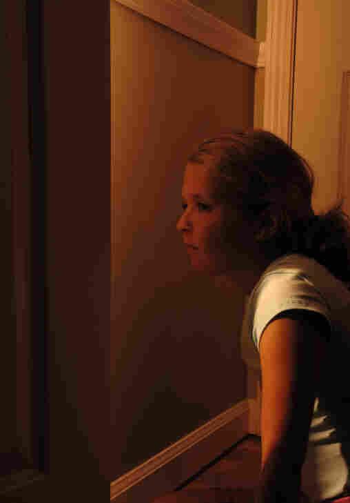 Peeping through the door crack.