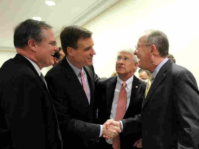 Sen. Mark Pryor, D-Ark., Sen. Mark Warner, D-Va., Sen. Lamar Alexander, R-Tenn., and Sen. Roger Wicker, R-Miss., greet each other at a news conference Nov. 16, 2011 on Capitol Hill in Washington, D.C.
