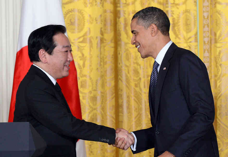 U.S. President Barack Obama shakes hands with Japan's Prime Minister Yoshihiko Noda during a joint press conference in the East Room at the White House in Washington, DC, on Monday.