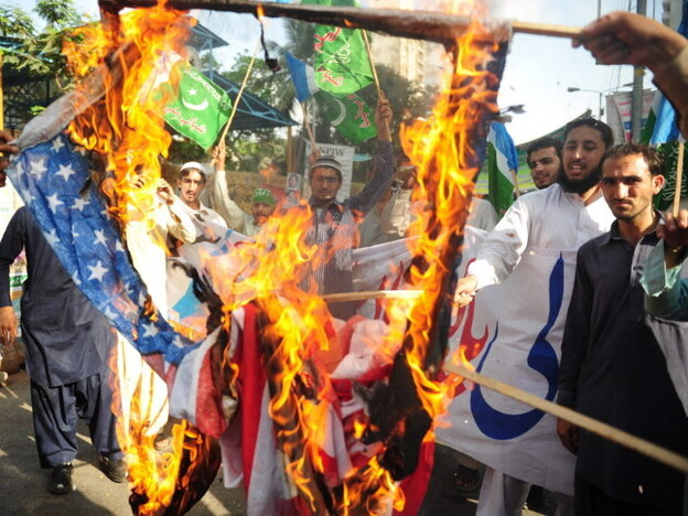 April 13: In Karachi, activists from the Shabab-e-Milli group set fire to U.S. fla