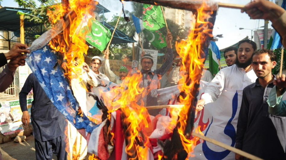 April 13: In Karachi, activists from the Shabab-e-Milli group set fire to U.S. flags during a protest against the reopening of the NATO supply route to Afghanistan. (AFP/Getty Images)