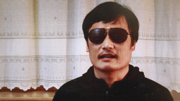 Blind lawyer Chen Guangcheng, seen in this image from a YouTube video, escaped last week after 19 months under house arrest. Searches for his name are banned on China's Twitter-like services. (AP)