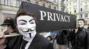Demonstrators with Guy Fawkes masks protest changing privacy policies on March 31, in Vienna.