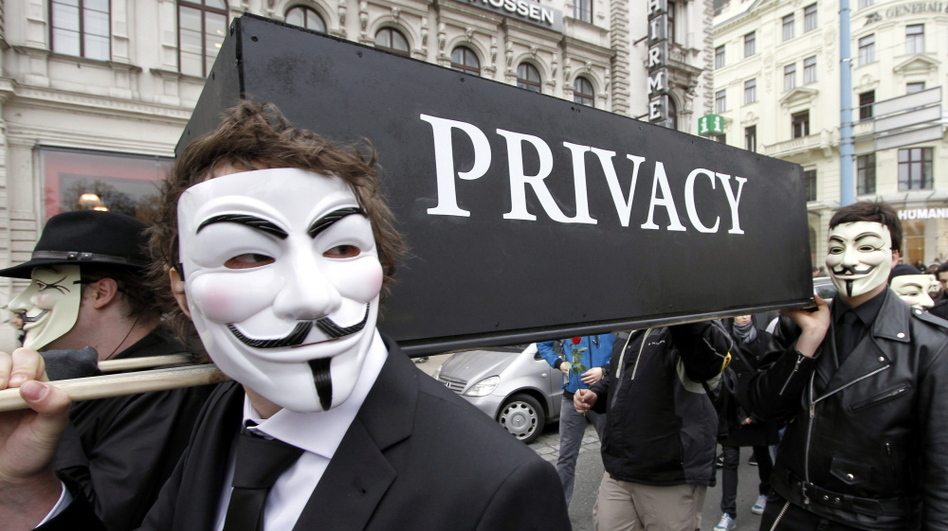Demonstrators with Guy Fawkes masks protest changing privacy policies on March 31, in Vienna. (DAPD/AP)