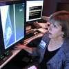 Karen Lindsfor, a professor of radiology and chief of breast imaging at the University of California, Davis Medical Center, examines the mammogram of a patient with heterogeneously dense breast tissue. Lindfors is among those doctors who say there was insufficient evidence to support the idea that additional screenings would detect cancers earlier.
