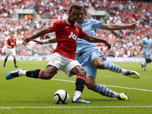 Manchester United's Nani (in red) and Manchester City's Aleksandar Kolarov during a game last August in London.