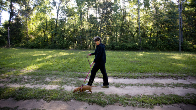 Teresa MacBain walks her dog, Gracie, at a park near her Tallahassee, Fla., home. After a lifetime in the church, MacBain came out as an atheist at an American Atheists' convention in Bethesda, Md.