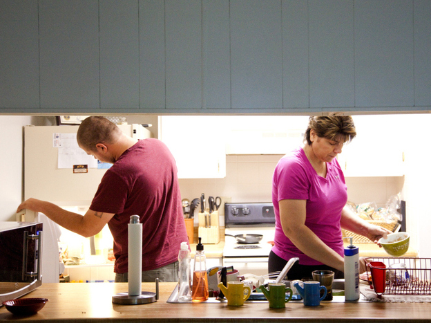 Teresa MacBain makes breakfast for her son David, 22, while he is home on leave from serving in the Army. MacBain says she is still adjusting to life outside the church.