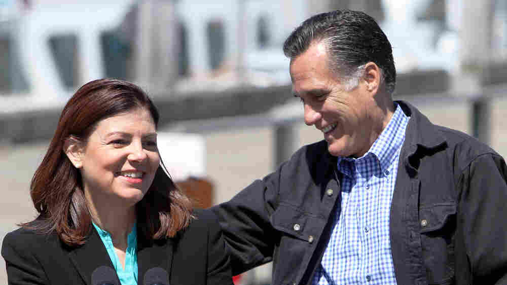 Republican presidential candidate Mitt Romney campaigns with Sen. Kelly Ayotte on Monday in Portsmouth, N.H. A 43-year-old freshman senator, Ayotte is among those under consideration as a vice presidential running mate, according to a Romney adviser.