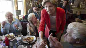 U.S. Senate candidate Elizabeth Warren, a Democrat, greets people at Dinky's Blue Belle Diner in Shrewsbury, Mass., on Sunday.