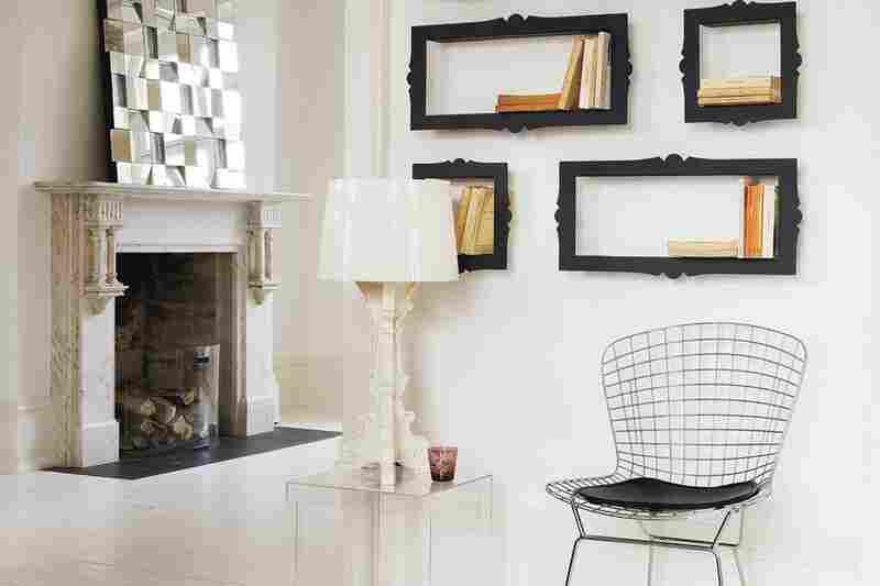 """Barok: Black metallic bookshelves are used to """"frame"""" books."""