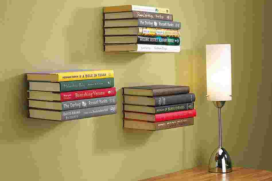 Conceal Shelf: These shelves appear to defy gravity. Hooks hold the cover of the bottom book to screen the metal plate that bears the weight.