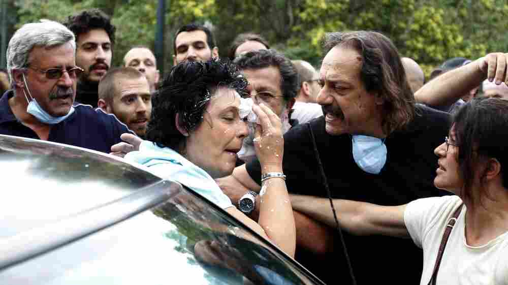 Communist Party of Greece lawmaker Liana Kanelli enters her car after protesters threw yogurt at her as she tried to reach the Greek Parliament on June 29, during a 48-hour general strike in Athens. Such attacks are not uncommon in Greece, where ordinary Greeks' anger over the debt crisis and austerity measures is boiliing over.
