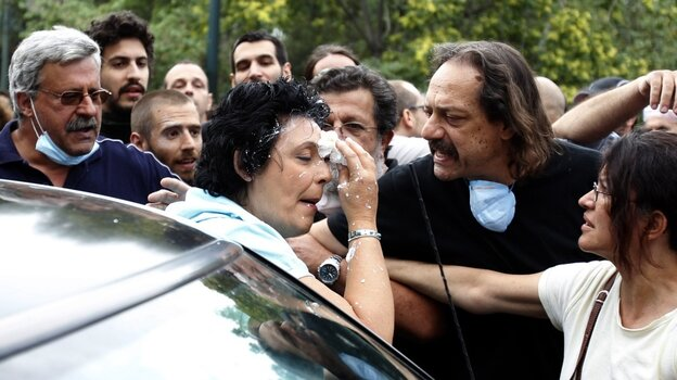 Communist Party of Greece lawmaker Liana Kanelli enters her car after p