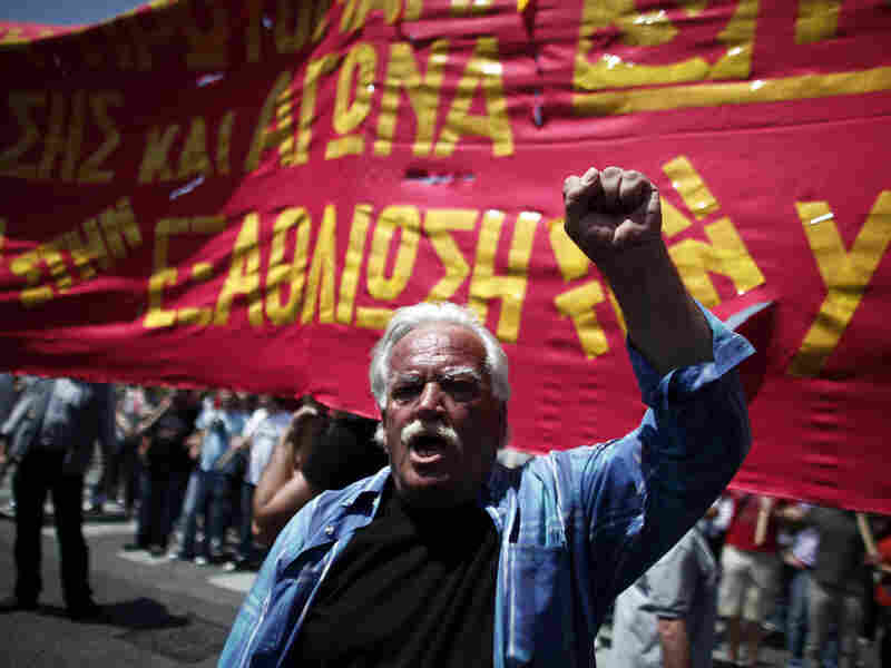 A protester shouts slogans during a May Day protest in Athens on Tuesday. In debt-crippled Greece, more than 2,000 people marched through central Athens in subdued protests centered on the country's harsh austerity program, ahead of elections scheduled for May 6.