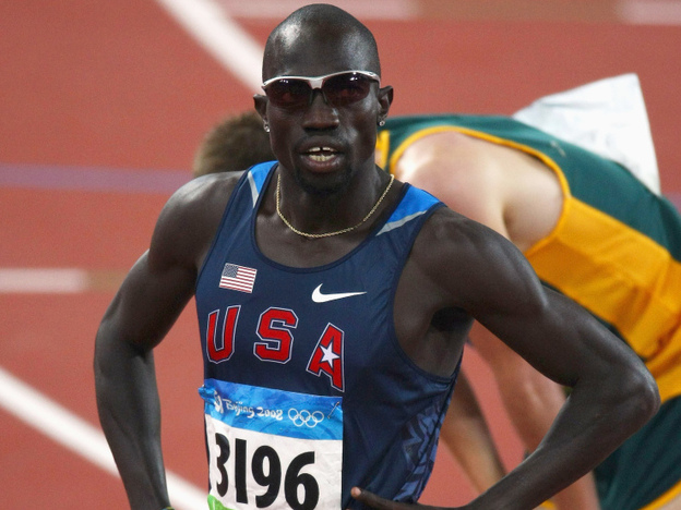 In his first race at the 5000-meter distance, runner Lopez Lomong set a 2012 world record. But the American also ran into some unusual trouble late in the race. This file photo shows Lomong at the 2008 Olympics. (Getty Images)