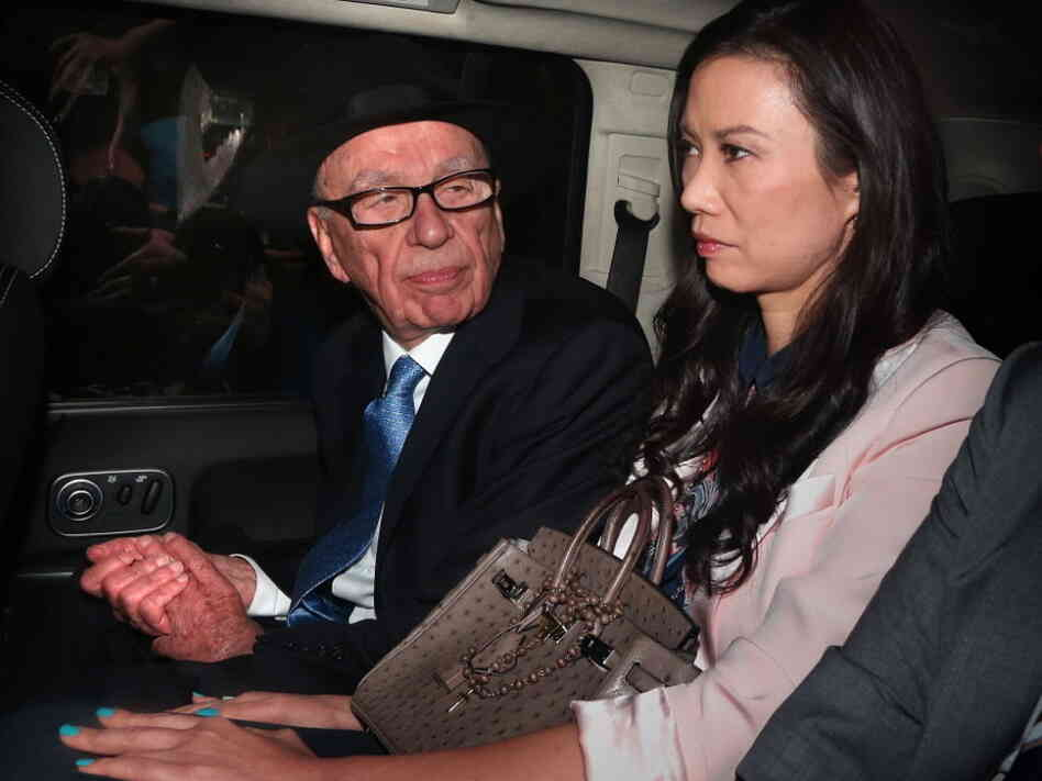 Rupert Murdoch and his wife, Wendi Deng Murdoch, as they were being driven away from the Royal Courts of Justice following his testimony last Thur