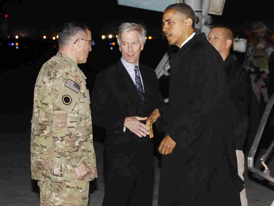 """President Barack Obama is greeted by Lt. Gen. Curtis """"Mike"""" Scaparrotti, and U.S. Ambassador to Afghanistan Ryan Crocker as he steps off Air Force One at Bagram Air Field in Afghanistan earlier today (Tuesday, May 1)."""