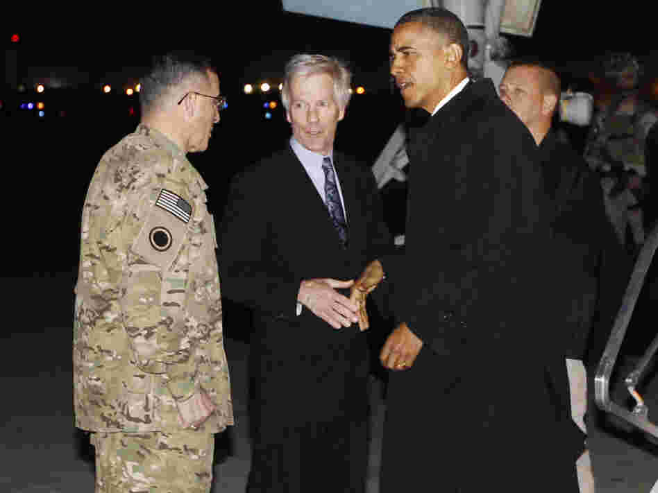 "President Barack Obama is greeted by Lt. Gen. Curtis ""Mike"" Scaparrotti, and U.S. Ambassador to Afghanistan Ryan Crocker as he steps off Air Force One at Bagram Air Field in Afghanistan earlier today (Tuesday, May 1)."