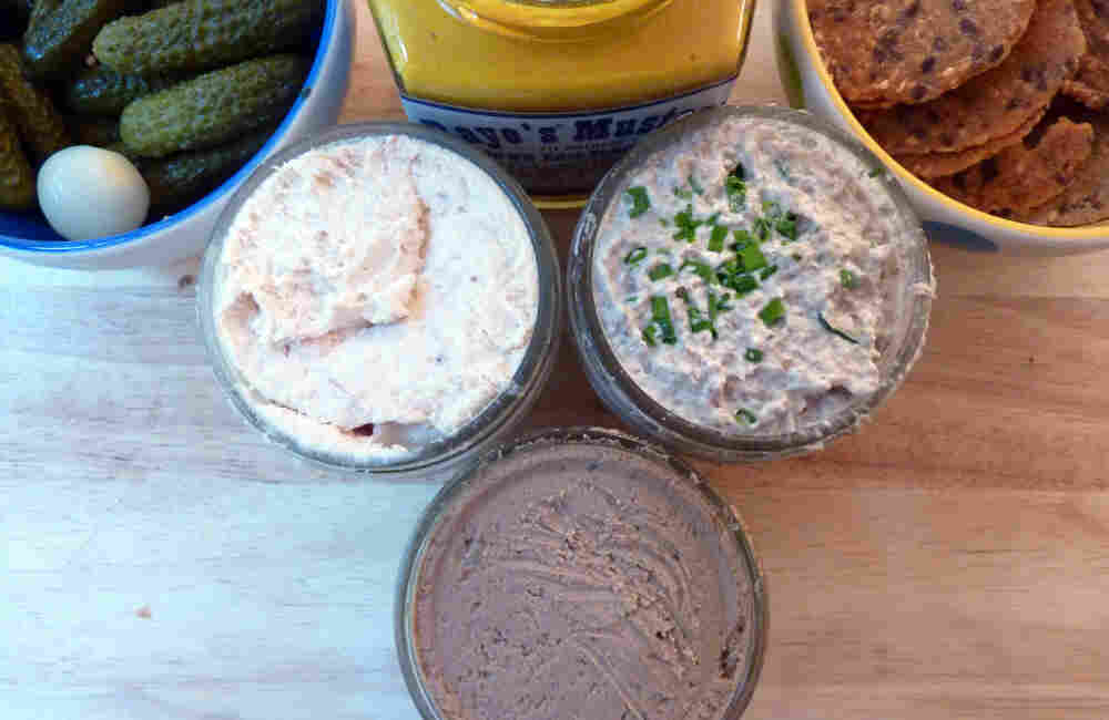 Smoked Trout Pate (left), Tuscan Chicken Liver Pate and Mushroom Pate (right) are served with cornichons, mustard and crackers.