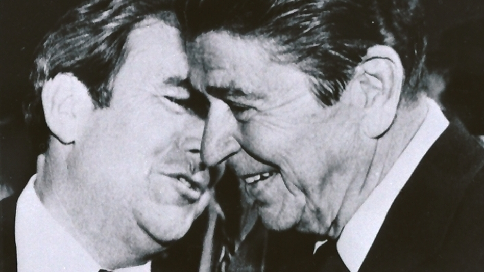 Republican presidential hopeful Ronald Reagan, right, listens to the Rev. Jerry Falwell during a campaign stop in Lynchburg, Va., in October 198 (AP)