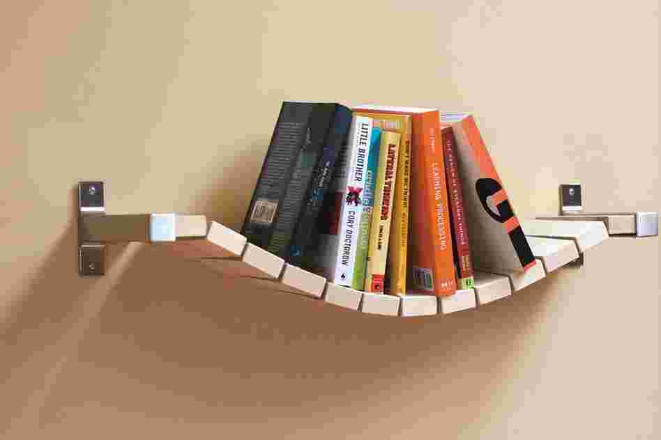 "Rope Bridge Bookshelf: ""Most bookshelves require bookends to keep the books up,"" says designer Ed Lewis, ""but I thought that a more relaxed approach would keep them all pushed to the middle, thus the Rope Bridge Bookshelf."""